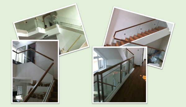 Glass panel railing with wooden top