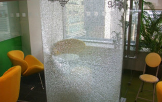 Shattered meeting room glass panel